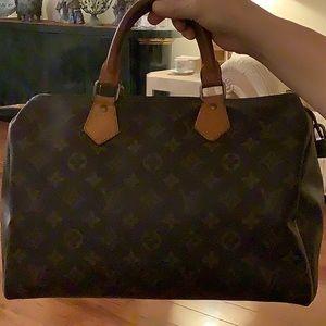 Louis Vuitton  Authentic good condition $ 500